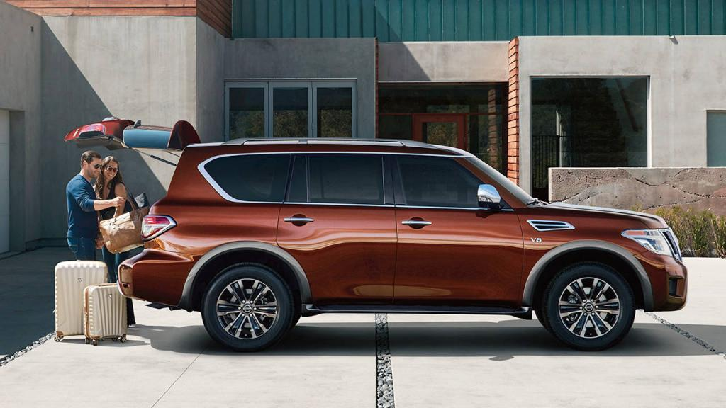 Nissan Armada Platinum® shown in Forged Copper, highlighting power liftgate