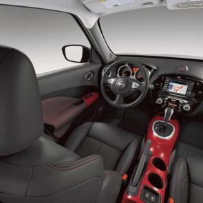 2017 Nissan JUKE® SL interior shown in Red/Black Leather, highlighting NissanConnect℠ navigation system