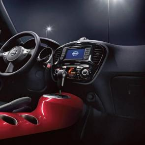 2017 Nissan JUKE® interior center console shown in Red