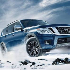 Nissan Armada® Platinum shown in Hermosa Blue, highlighting side and rear privacy glass