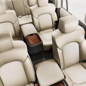 Nissan Armada® Platinum interior shown in Almond Leather with Captain Chairs